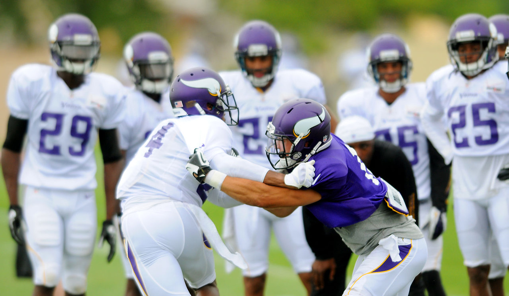 . Background, from left, Xavier Rhodes, Greg  McCoy,  Harrison Smith, Marcus Sherels and Roderick  Williams watch cornerback A.J.  Jefferson, left foreground and wide receiver Adam Thielen match up during drills.  (Pioneer Press: John Autey)