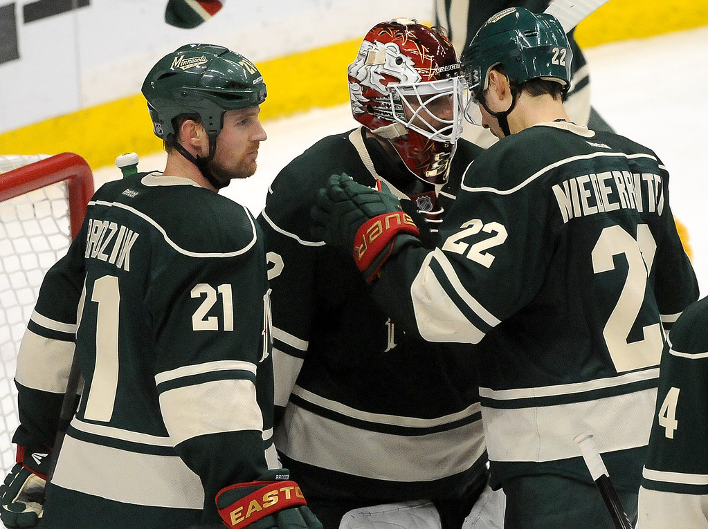 . Minnesota Wild Kyle Brodziak, left, and  Nino Niederreiter, right, celebrate the win with teammate Minnesota Wild goalie Niklas Backstrom, middle, after the 5-3 win. (Pioneer Press: Sherri LaRose-Chiglo)