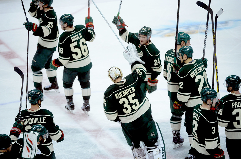 . Minnesota Wild players celebrate their 1-0 overtime win over Colorado at center ice. (Pioneer Press: Sherri LaRose-Chiglo)