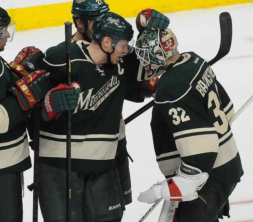 . Minnesota Wild center Mikko Koivu celebrates the 4-3 win with goalie Niklas Backstrom. (Pioneer Press: Sherri LaRose-Chiglo)