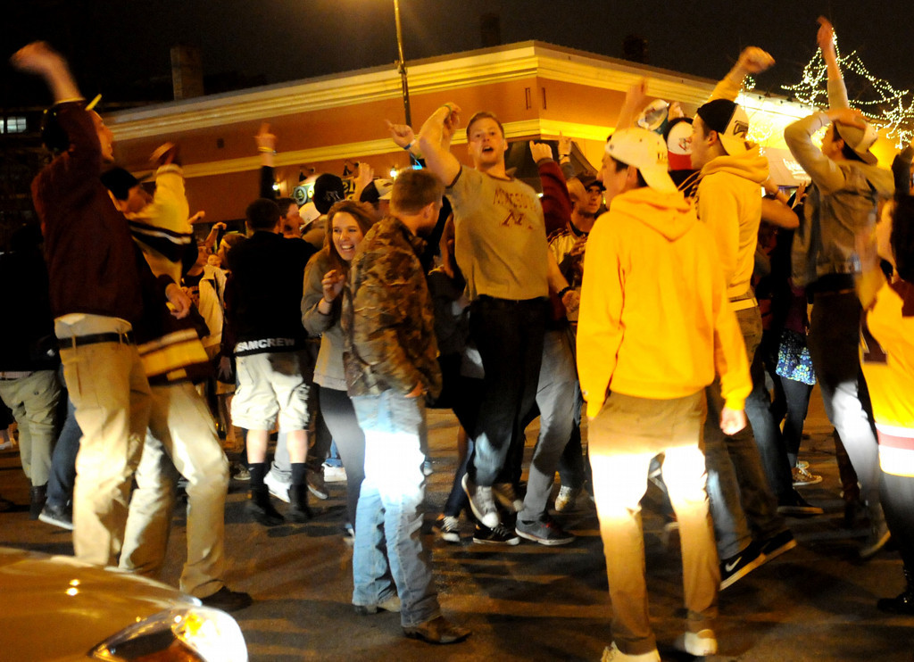 . Minnesota hockey fans begin the disturbance in the intersection by jumping up and down on Saturday night and blocking cars. (Pioneer Press: Sherri LaRose-Chiglo)