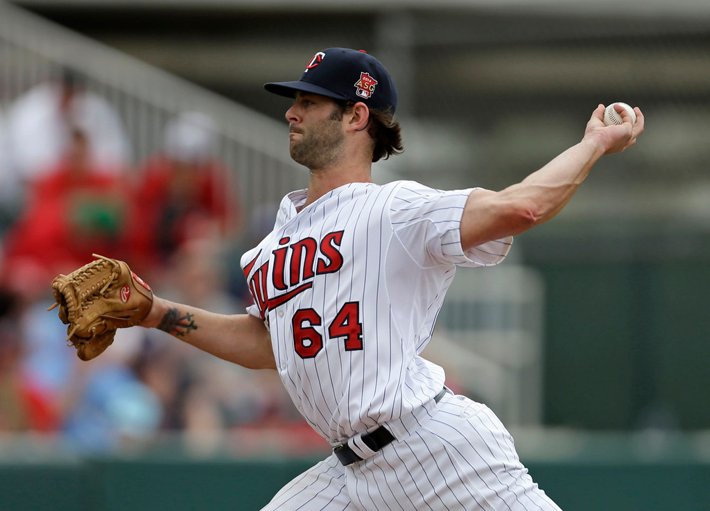 . Twins reliever Aaron Thompson pitches in the sixth inning against the Red Sox. (AP Photo/Gerald Herbert)