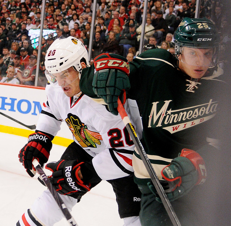 . Wild defenseman Jonas Brodin, right and Chicago winger Brandon Saad fight for position behind the Minnesota goal during the second period. (Pioneer Press: John Autey)