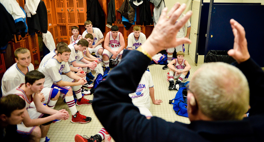 """. Chisholm boys basketball coach Bob McDonald has a word with his team in the locker room before playing Nashwauk-Keewatin in Nashwauk last week. �Many people say that I am hard-nosed and I am OK with that,�� he said. �When you are hard-nosed about scholastics and behavior, well, that isn�t hard-nosed, that is common sense.\""""  (Pioneer Press: Ben Garvin)"""