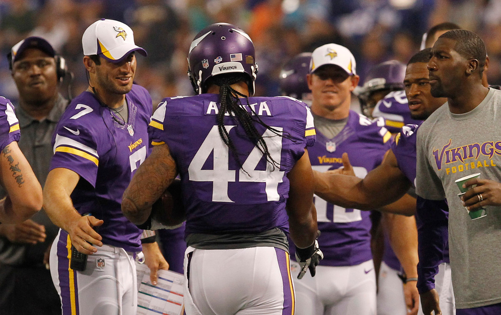 . Vikings running back Matt Asiata celebrates with teammates after scoring on a one-yard touchdown run at the start of the second quarter against the Titans. (AP Photo/Ann Heisenfelt)