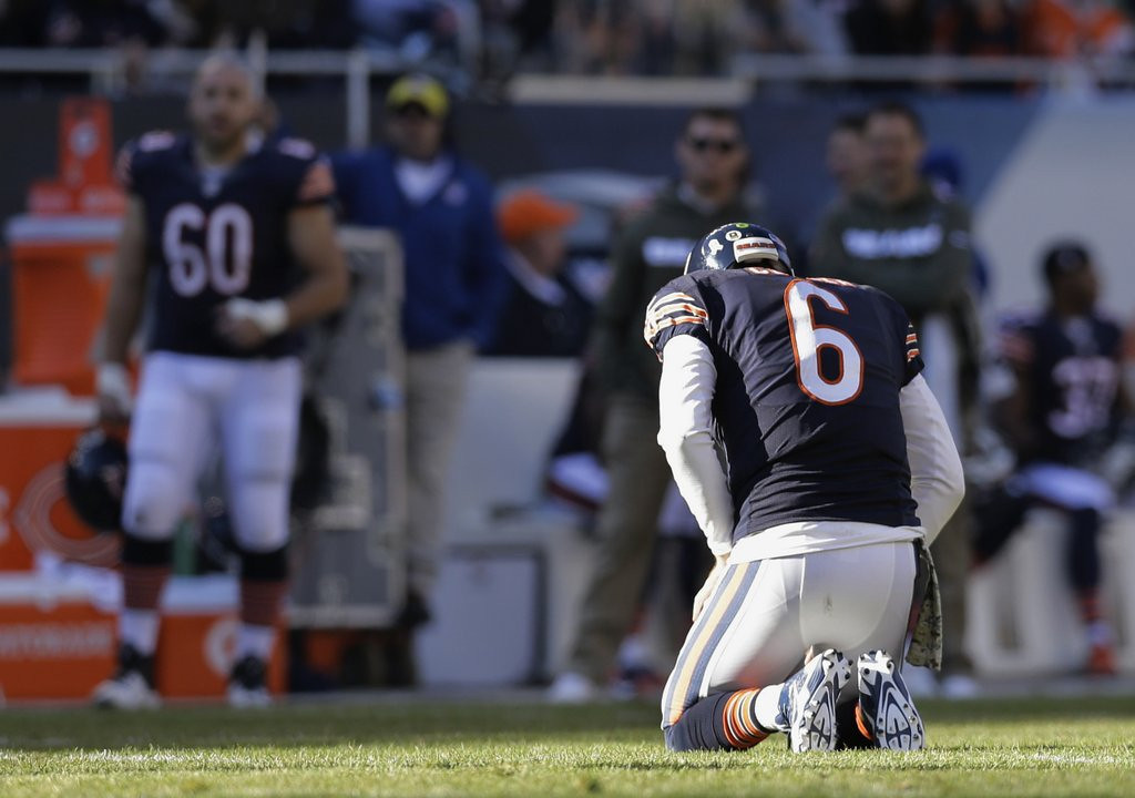 . <p><b> Bears at Browns (-1):</b> <p>Chicago coach Marc Trestman insists that injured QB Jay Cutler will replace red-hot Josh McCown just as soon as he is healthy enough to play. This increases the likelihood that some random Bears fan will try to help out the team by hitting Cutler with his car. <p>Pick: <b>Bears by 7</b> <p>     (AP Photo/Nam Y. Huh)