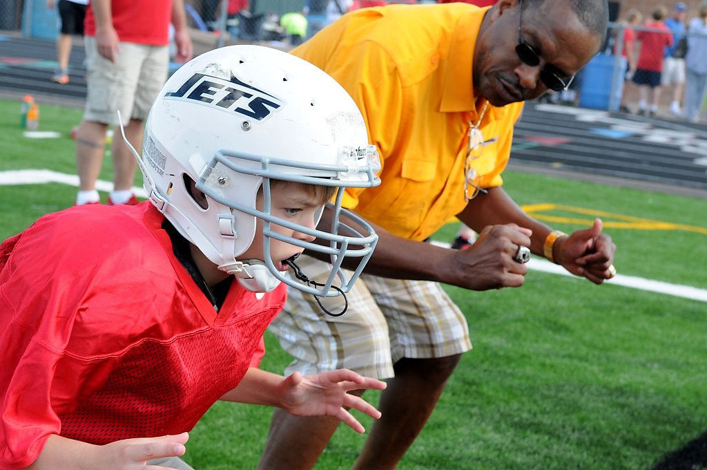 """. Luke Schneider gets some blocking tips from John Swain during Centennial�s first \""""Cougar Combine\"""" event July 28 in Circle Pines. (Pioneer Press: Sherri LaRose-Chiglo)"""