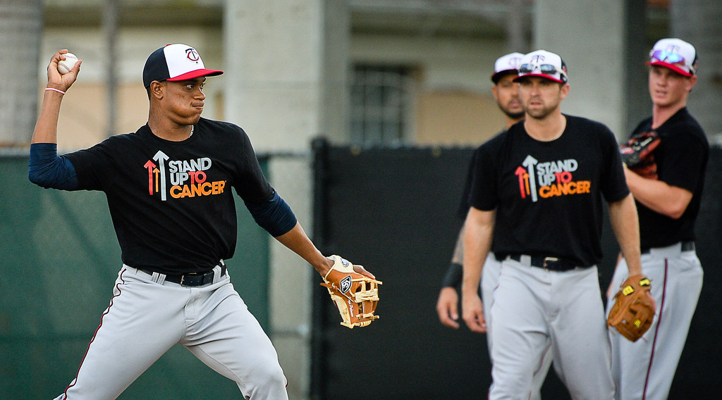 . Twins rookie infielder Jorge Polanco throws to first during Kelly\'s drill. (Pioneer Press: Ben Garvin)