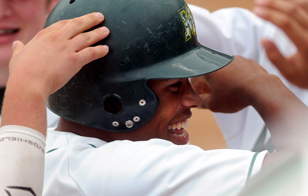 . Mounds View outfielder Alec Abercrombie is congratulated after he scored a run in the fifth inning, shortly after hitting a double that drove in two runs. (Pioneer Press: Chris Polydoroff)