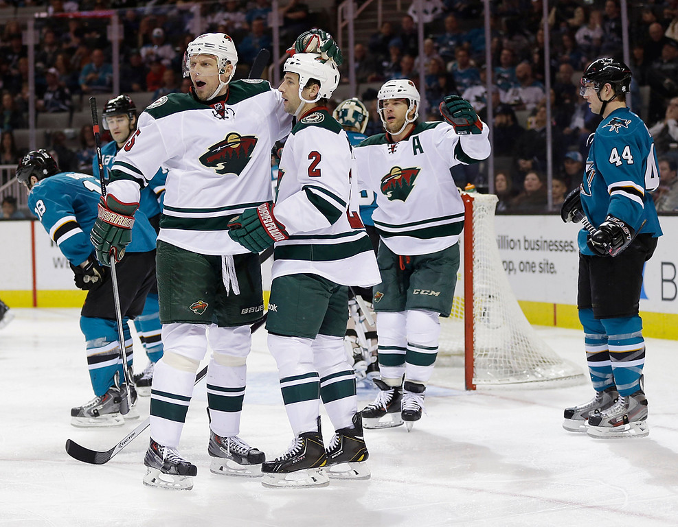 . Minnesota Wild\'s Keith Ballard (2) celebrates his goal with teammate Dany Heatley (15) during the second period of an NHL hockey game against the San Jose Sharks on Saturday, Jan. 25, 2014, in San Jose, Calif. (AP Photo/Marcio Jose Sanchez)