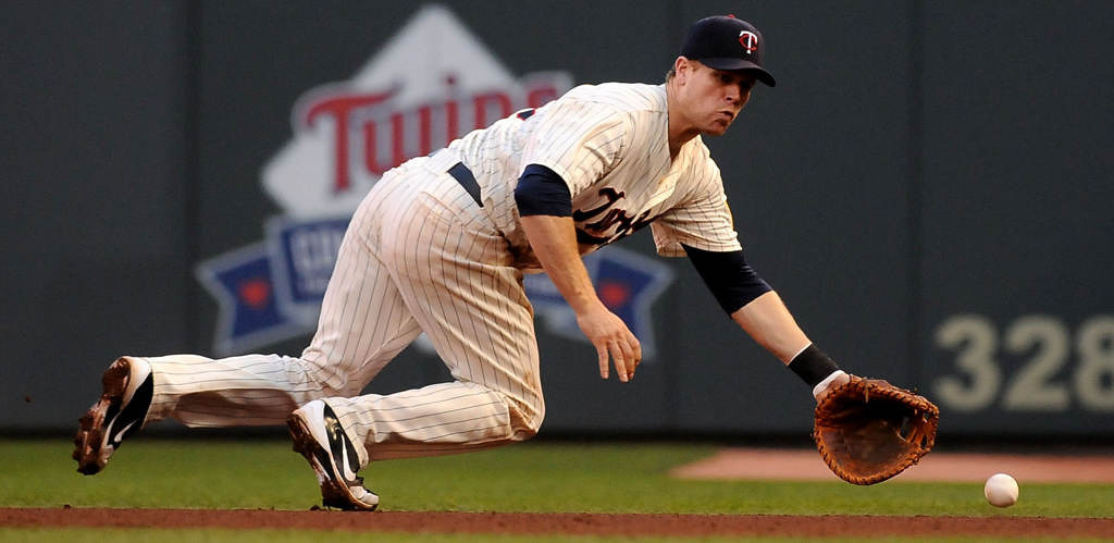 . The Minnesota Twins\' Justin Moreau fields a grounder hit by Detroit\'s Alex Avila during the seventh inning Saturday, June 15, 2013, at Target Field. The Twins beat the Tigers 6-3. (Pioneer Press: Sherri LaRose-Chiglo)