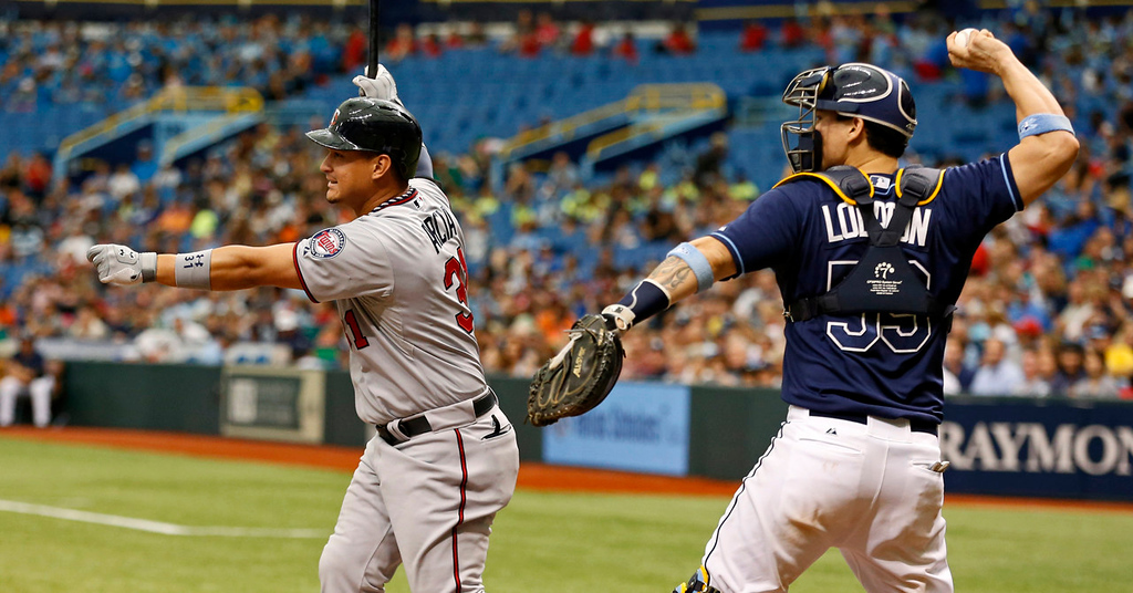 . Minnesota\'s Oswaldo Arcia, left, strikes out in front of  Rays catcher Jose Lobaton during the ninth inning. (AP Photo/Mike Carlson)