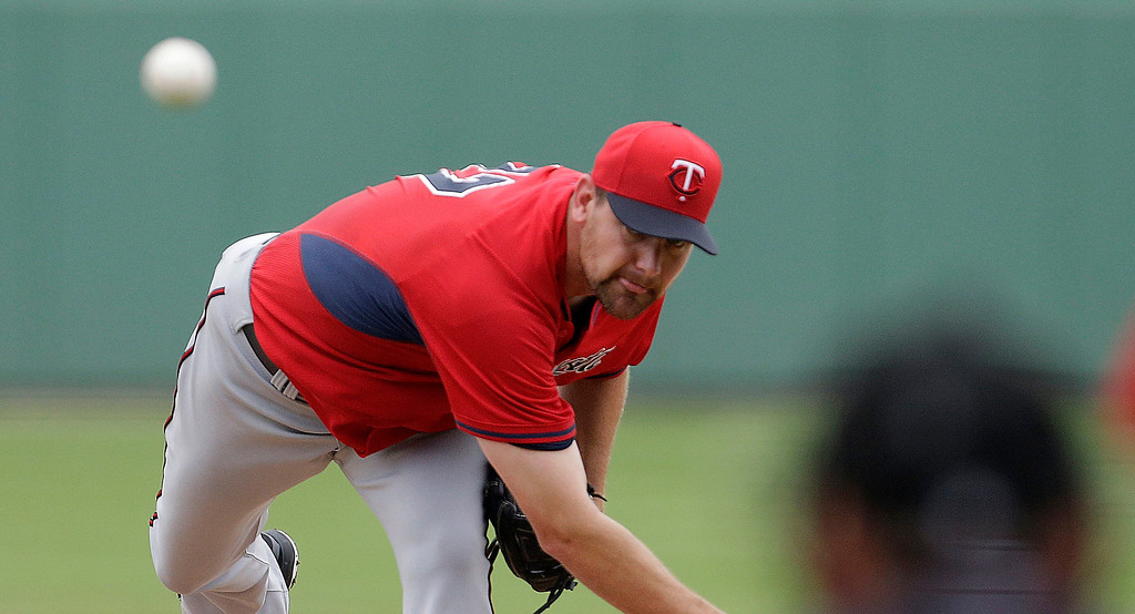 . Minnesota Twins starting pitcher Mike Pelfrey pitches during the first inning of an exhibition baseball game against the Boston Red Sox in Fort Myers, Fla., Saturday, March 29, 2014. (AP Photo/Gerald Herbert)