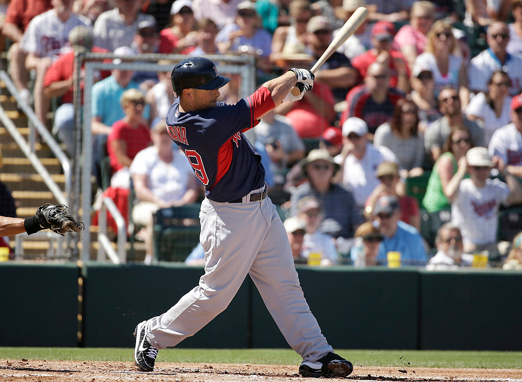 . Boston Red Sox\'s Daniel Nava follows through with his swing on a home run hit off a pitch by Minnesota Twins\' Scott Diamond in the first inning of an exhibition baseball game, Saturday, March 1, 2014, in Fort Myers, Fla. (AP Photo/Steven Senne)