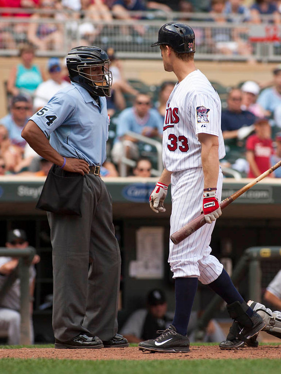 . Minnesota Twins Justin Morneau  looks back at home plate umpire CB Bucknor after being called out on strikes during the ninth inning. Chicago won 5-2. (AP Photo/Paul Battaglia)