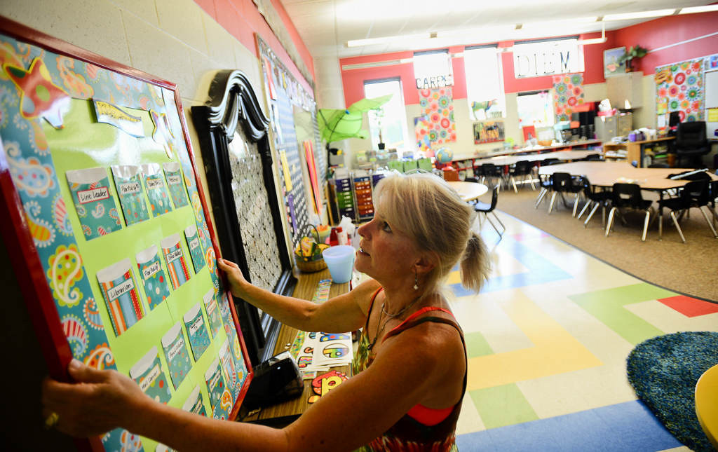 . Teacher Anne Miller adjusts a board in her second-grade classroom. (Pioneer Press: Ben Garvin)