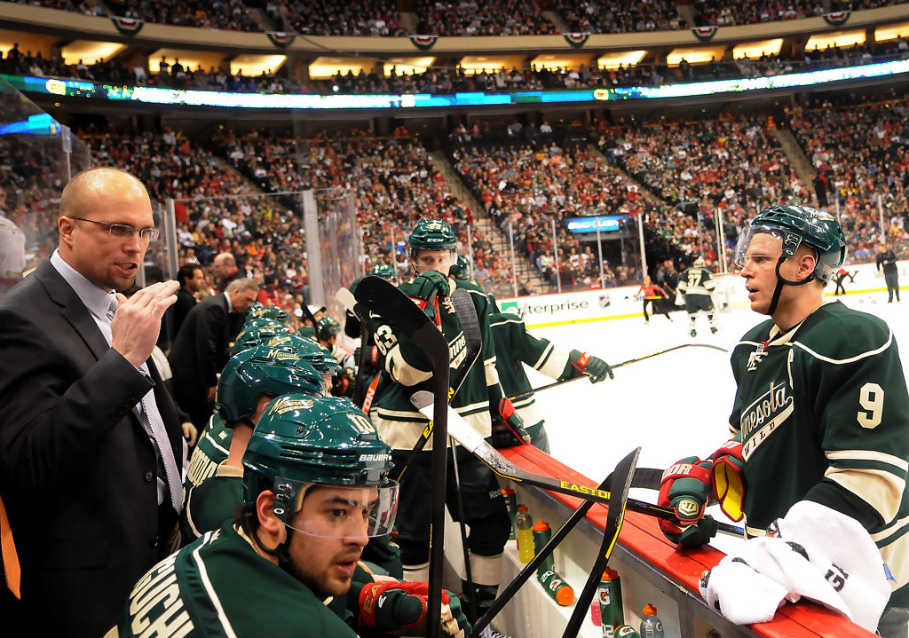 . Minnesota head coach Mike Yeo gives instructions to his first line during a time out in the third period against Chicago. (Pioneer Press: John Autey)