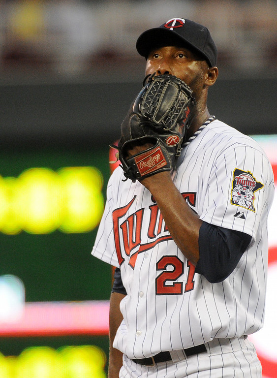 . Twins starting pitcher Samuel Deduno collects his thoughts after giving up an RBI single to the Yankees\' Ichiro Suzuki during the fifth inning. (Pioneer Press: John Autey)