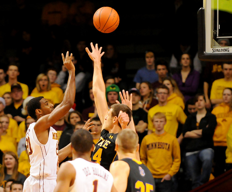 . Minnesota guard Austin Hollins shoots for two over South Dakota State guard Zach Horstman in the second half. (Pioneer Press: John Autey)