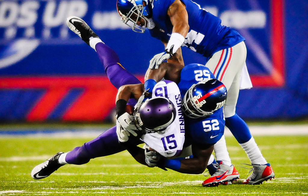 . Vikings wide receiver Greg Jennings is taken down by Giants middle linebacker Jon Beason in the fourth quarter.  (Pioneer Press: Ben Garvin)