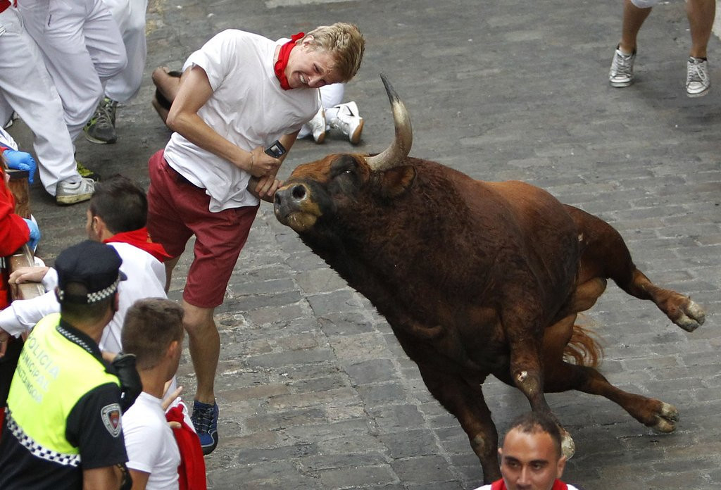 ". <p><b><a href=\'http://www.huffingtonpost.com/2013/07/14/australian-woman-gored-running-of-the-bulls-spain_n_3594354.html\' target=""_blank\""> 6. (tie) Running of the Bulls </a></b> <p>Some people just <i>deserve</i> to get a horn in their spleen. (unranked) <p> --------------------------------------------   (AP Photo)"
