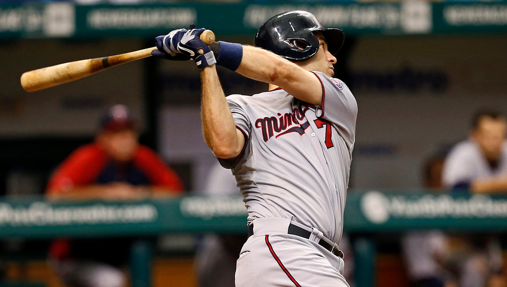 . Twins hitter Joe Mauer follows through on a single that knocked in two runs during the eighth inning against the Rays. (AP Photo/Mike Carlson)