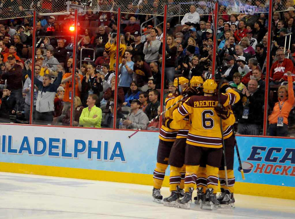 . The Gophers celebrate Minnesota freshman forward Taylor Cammarata goal against Union College in the second period of the NCAA Frozen Four Championship Game at the Wells Fargo Center in Philadelphia, Saturday, April 12, 2014.  (Pioneer Press: John Autey)