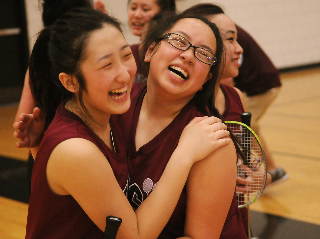 . Johnson High School senior Ka Lia Her, left, and junior Pang Xiong hug after winning their fourth state badminton team championship at the Minnesota State Badminton Tournament at Burnsville High School on Wednesday, May 15, 2013.   (Pioneer Press: John Autey)