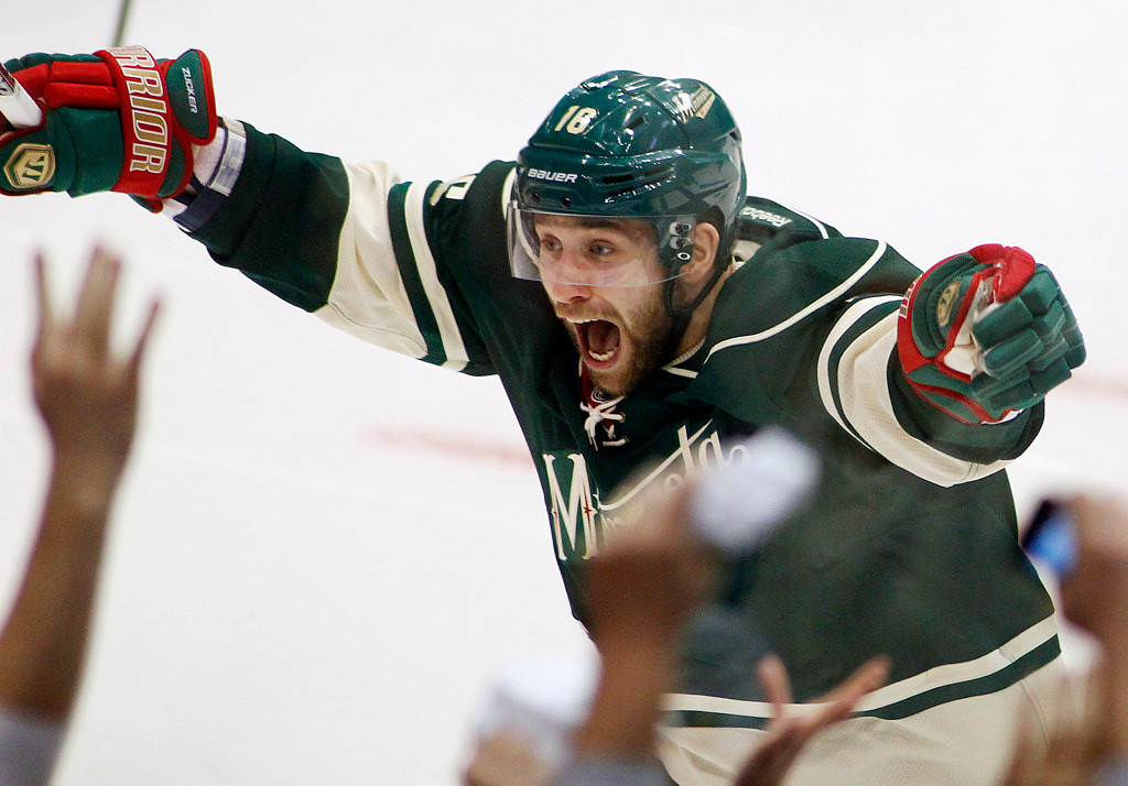 . Minnesota\'s Jason Zucker celebrates his overtime goal against the Blackhawks. (AP Photo/Andy King)