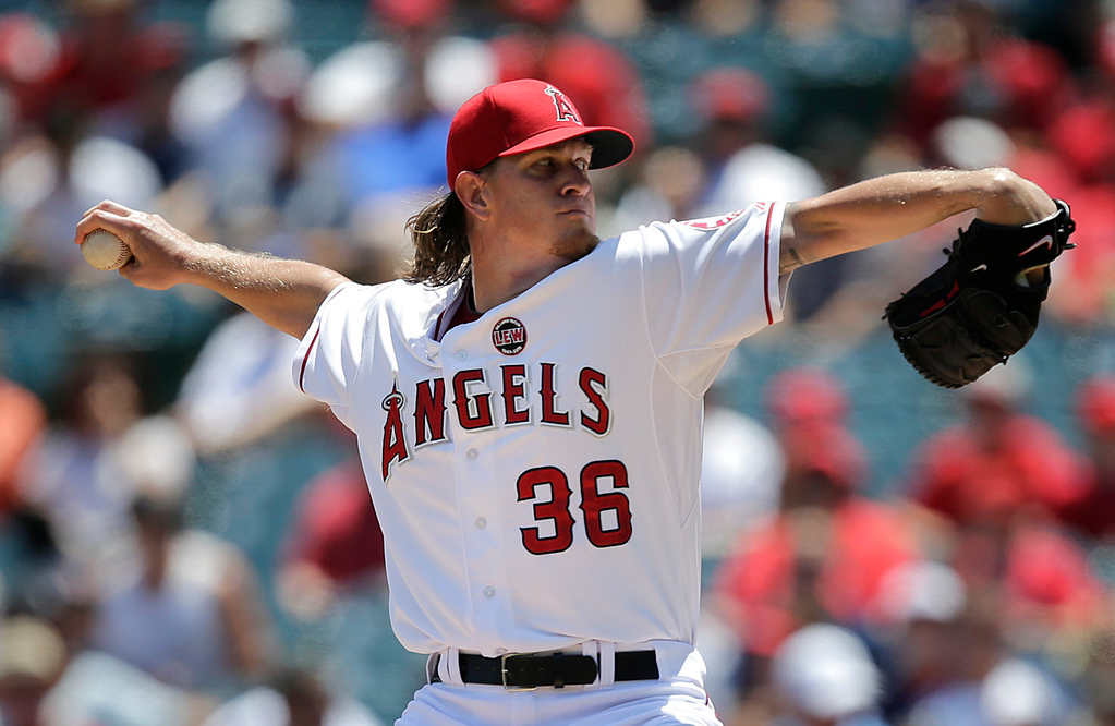 . Angels starting pitcher Jered Weaver allowed only two hits over eight innings, striking out nine Twins batters. (AP Photo/Jae C. Hong)