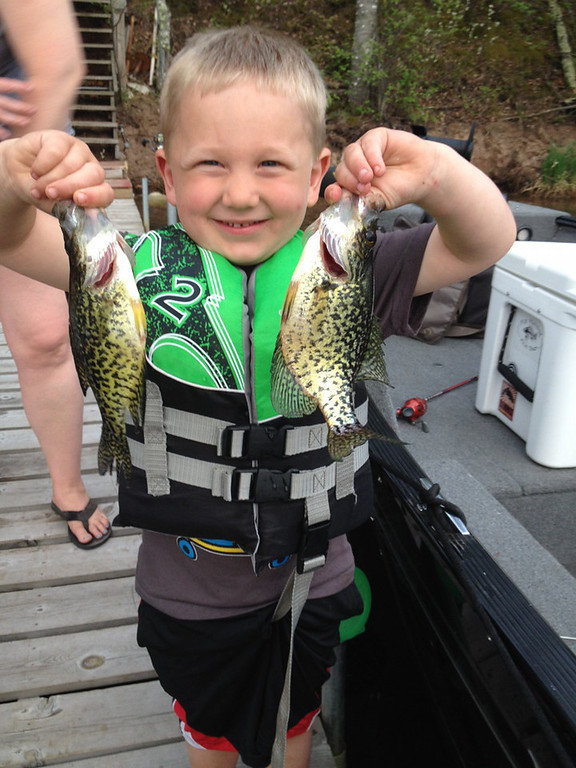 """. Mason Gonzalez, 3, of Cottage Grove, hooked these crappies -- his first -- May 25 in Minong, Wis. He reported the bites to his father, announcing, \""""My bobber is dancing, dad!\"""" (Photo courtesy Matt Gonzalez)"""
