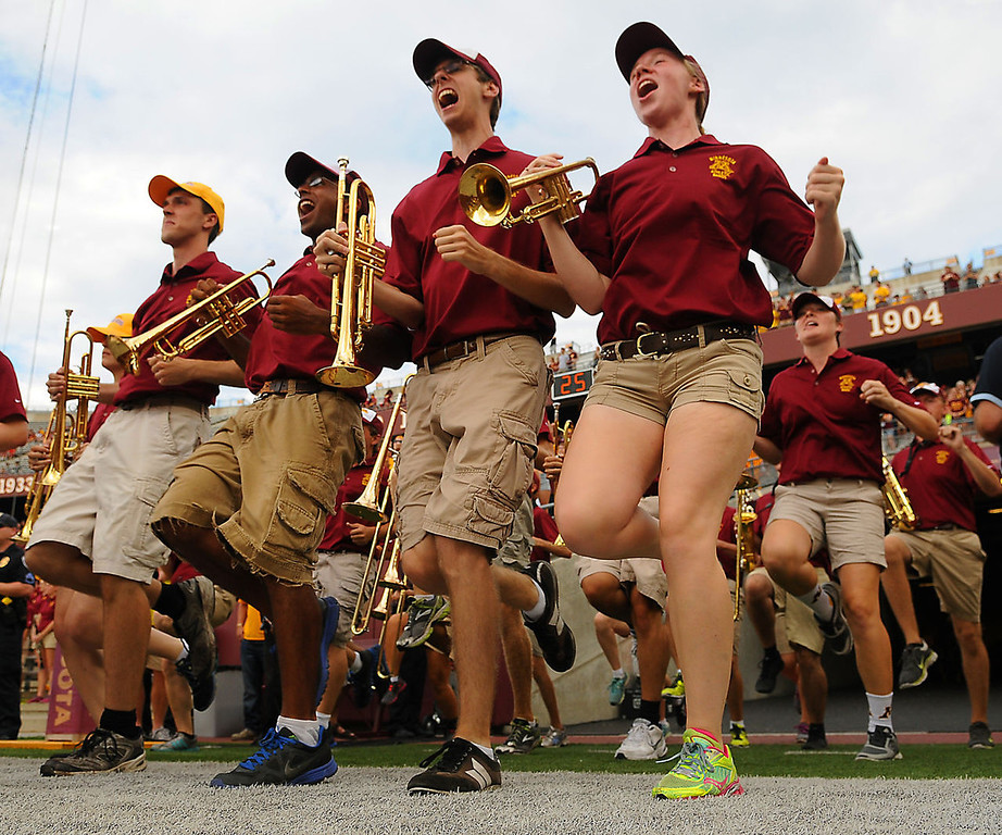 . The Minnesota Gophers Pep Band shakes a leg (many, actually) before the game. (Pioneer Press: John Autey)