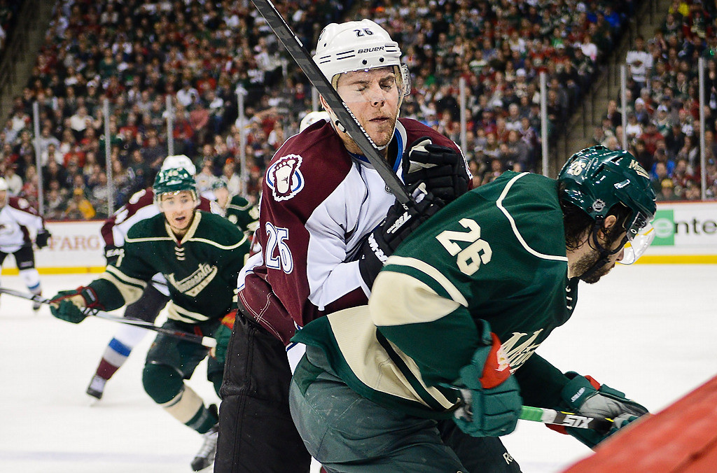 . Colorado Avalanche center Paul Stastny checks Minnesota Wild left wing Matt Moulson during the third period. (Pioneer Press: Ben Garvin)