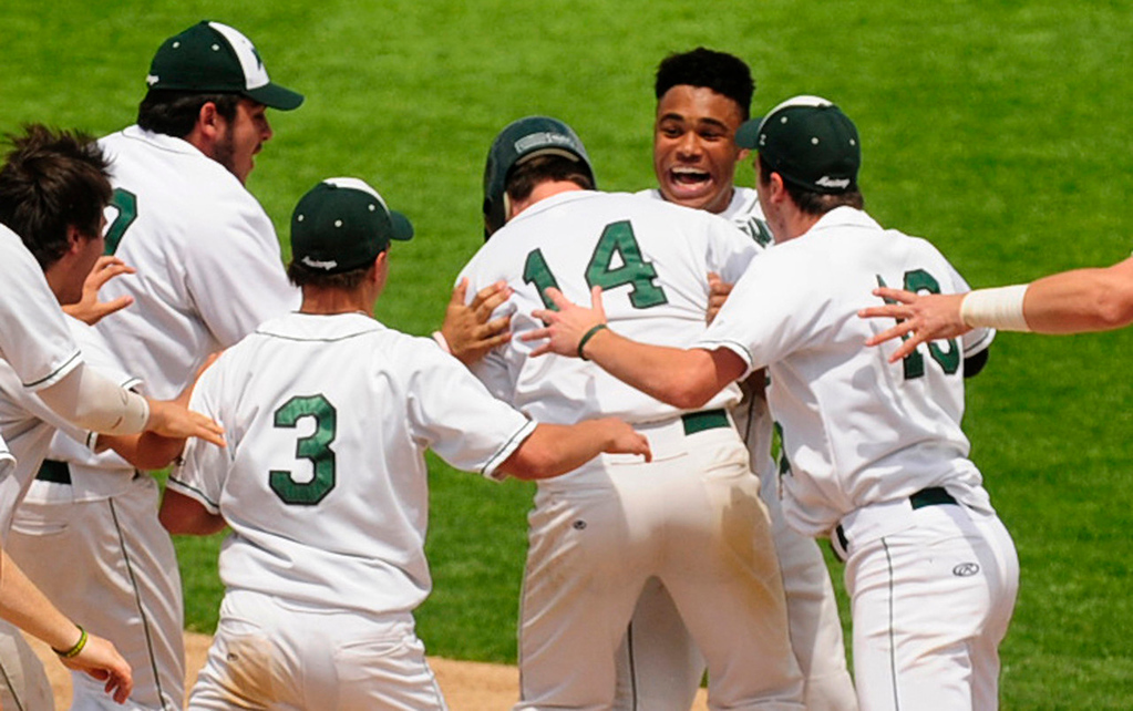 . Mounds View\'s Alec Abercrombie, second from right, is mobbed by his teammates after driving in the game-winning run  in the bottom of the seventh inning to give the Mustangs a 2-1 quarterfinal win over Forest Lake in the state Class 3A baseball tournament at Midway Stadium in St. Paul on Thursday, June 13, 2013.  (Pioneer Press: Scott Takushi)