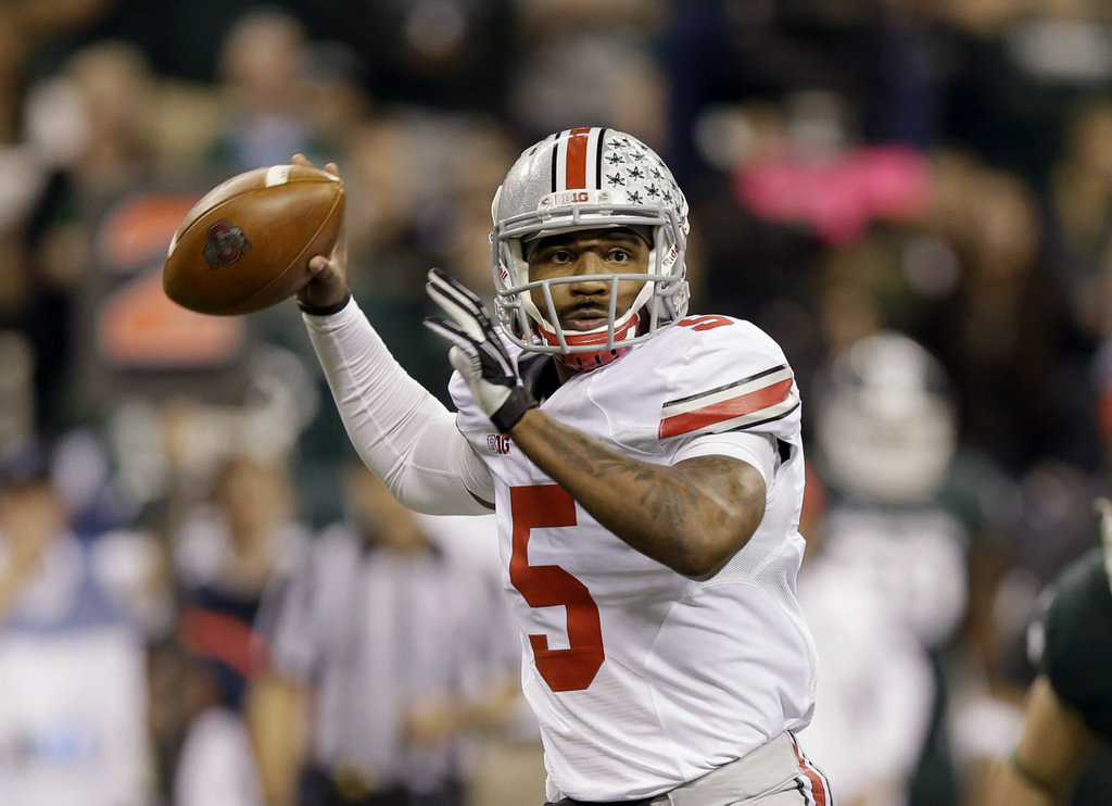 ". <p><b> Ohio State fans got terrible news Tuesday when they learned star quarterback Braxton Miller would miss the entire 2014 season because of an � </b> </p><p> A. Injured shoulder </p><p> B. Emergency appendectomy </p><p> C. Infected complementary tattoo </p><p><b><a href=""http://www.twincities.com/sports/ci_26361318/report-ohio-state-qb-braxton-miller-reinjures-shoulder\"" target=\""_blank\"">LINK</a></b> </p><p>    (AP Photo/Michael Conroy)</p>"
