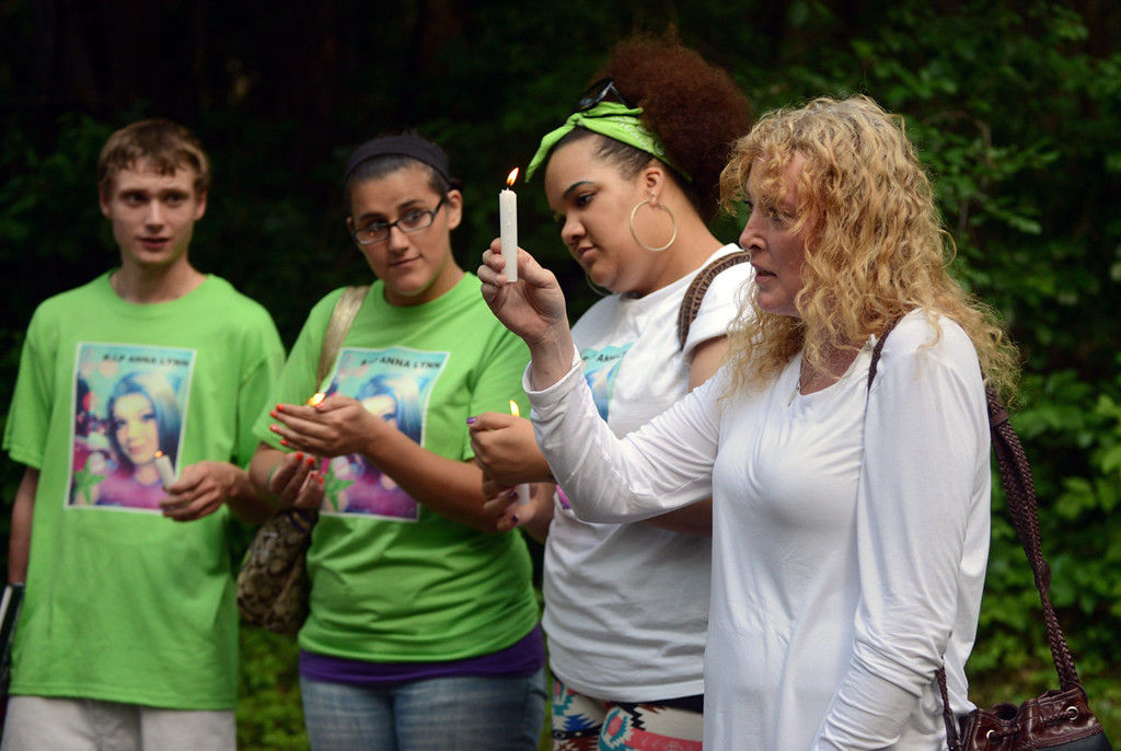 . Anna Hurd\'s mother, Jennifer Hutchings, right, speaks to a group of family and friends during a vigil Tuesday at Hillside Park in Maplewood, where her daughter was stabbed to death by Anthony Joseph Mitchell Jr. in February. (Pioneer Press: Chris Polydoroff)