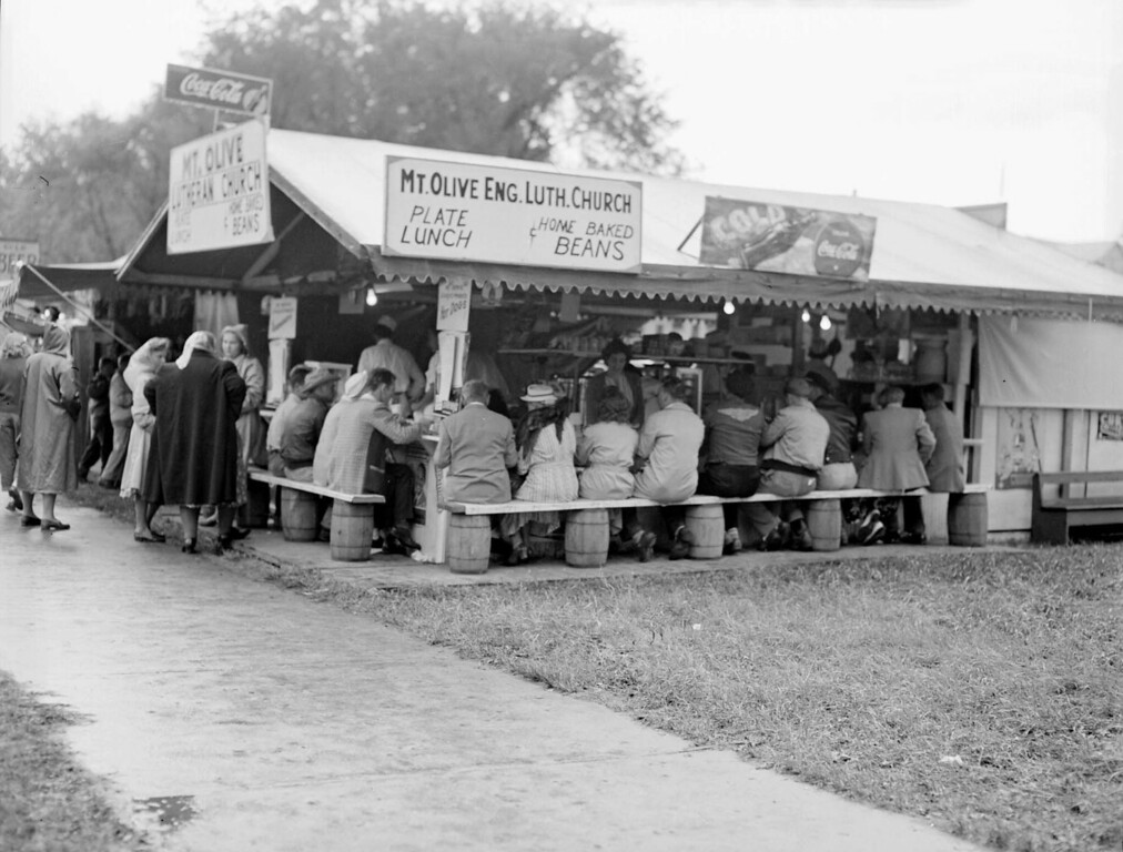 . People sit at the Mount Olivet Lutheran Church lunch booth on the Minnesota State Fair grounds on August 29, 1948. Photo courtesy of the Minnesota State Fair.