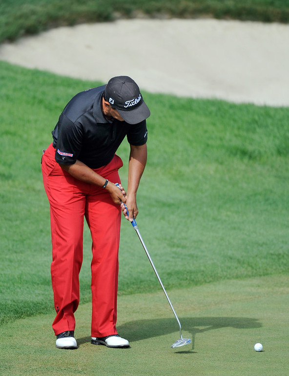 . Tom Pernice Jr. strokes a 15-foot putt for an eagle on the 18th hole during the final round of the 3M Championship. The putt came up short, and he tapped in for a birdie, a final score of 17 under par and possession of the championship trophy.  (AP Photo/Craig Lassig)