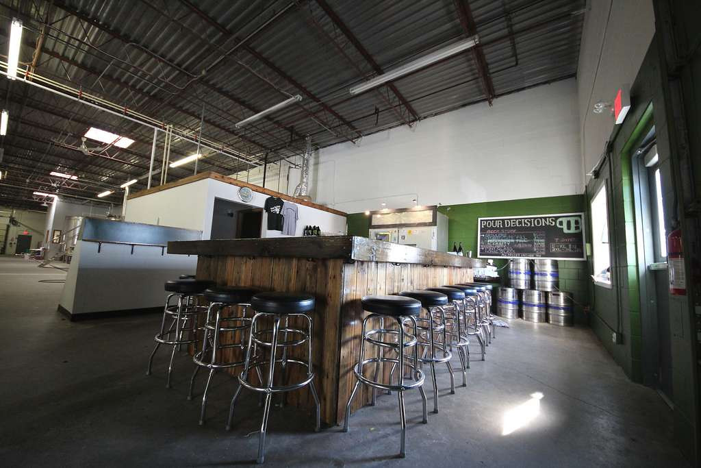 . Tucked into an industrial area of Roseville, Pour Decisions taproom has its own vibe -- workaday and dark, with the brewing equipment in full view of drinkers. (Courtesy of Pour Decisions)
