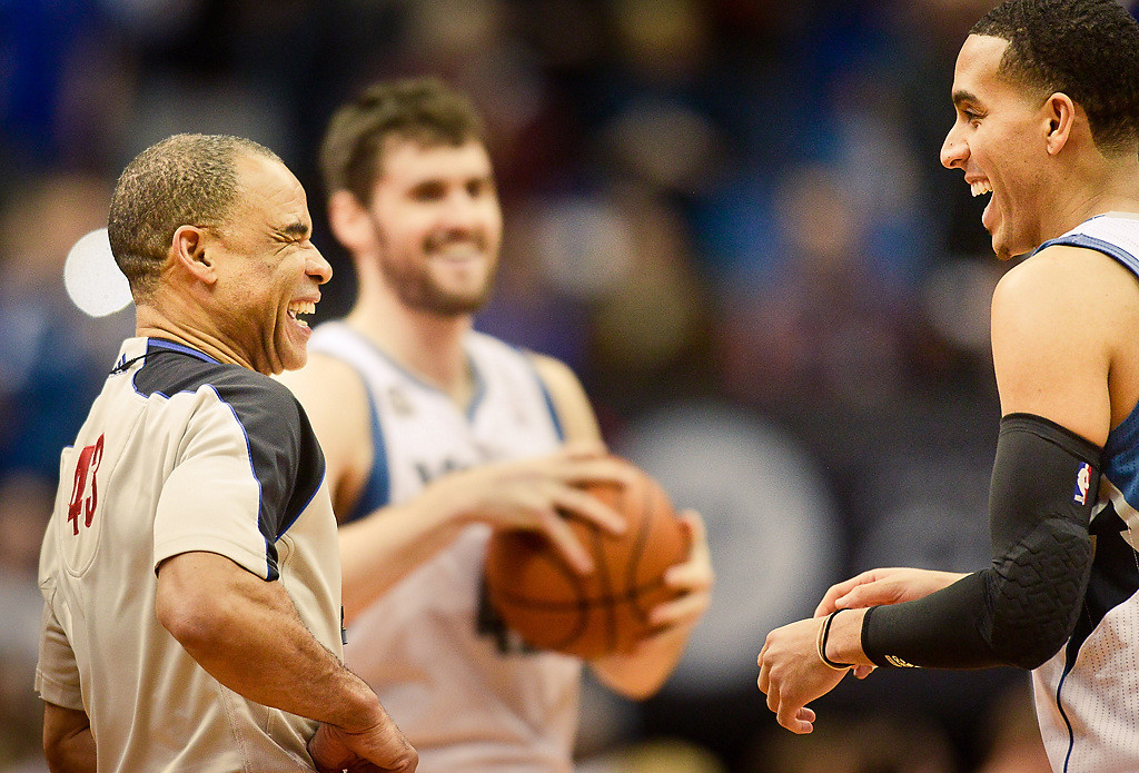 . Longtime NBA referee Dan Crawford has a laugh during the game with Timberwolves\' Kevin Martin, right, and Kevin Love. (Pioneer Press: Ben Garvin)