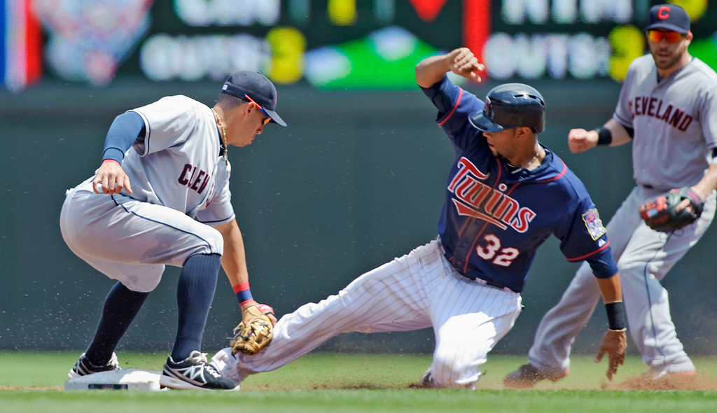 . Indians shorstop Asdrubal Cabrera slaps the tag on Twins base runner Aaron Hicks, who was caught stealing second base during the third inning. (Photo by Hannah Foslien/Getty Images)