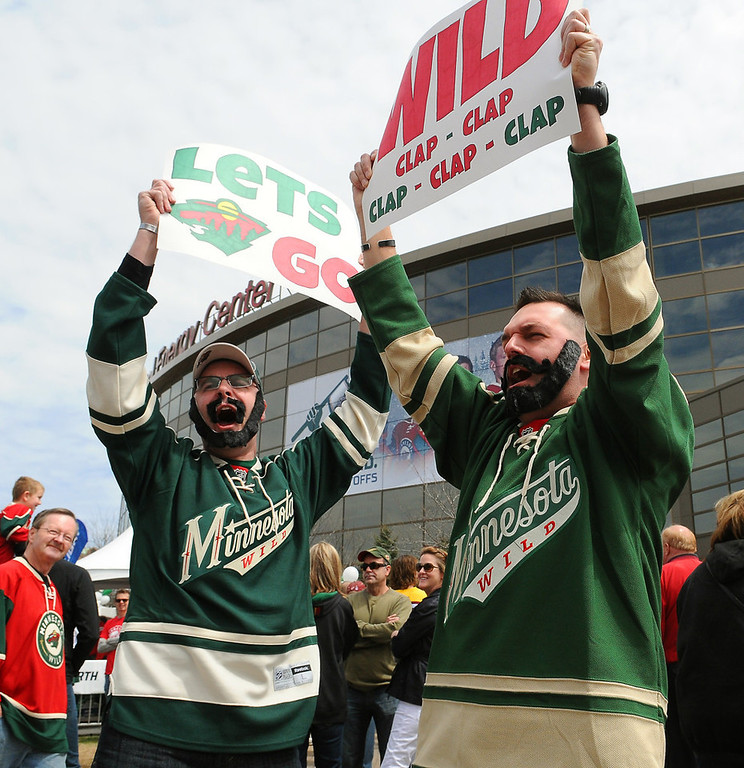 ". Bill Butler, left and Mike Lubovich, both of St. Paul, sport ""playoff beards\"" as they rally the crowd outside the Xcel Energy Center before the start of Game 3 against the Blackhawks. Butler said he started the beard Sunday morning.  (Pioneer Press: John Autey)"