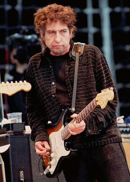 . 1997: Rock legend Bob Dylan plays his Fender Stratocaster in London\'s Hyde Park at the Mastercard Monsters of Music festival as seen in this June 1996 file photo. Dylan was hospitalized with a potentially fatal chest infection that forced him to cancel a European tour, the singer s record label said Wednesday, May 28, 1997. (AP Photo/Stefan Rousseau, File)(AP Photo/fls/Stefan Rousseau)