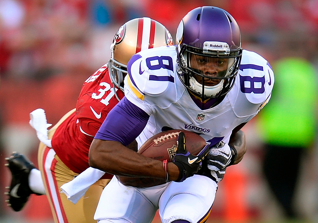 . Minnesota\'s Jerome Simpson gets tackled by San Francisco\'s Donte Whitner after a seventeen yard pass play in the second quarter.  (Photo by Thearon W. Henderson/Getty Images)