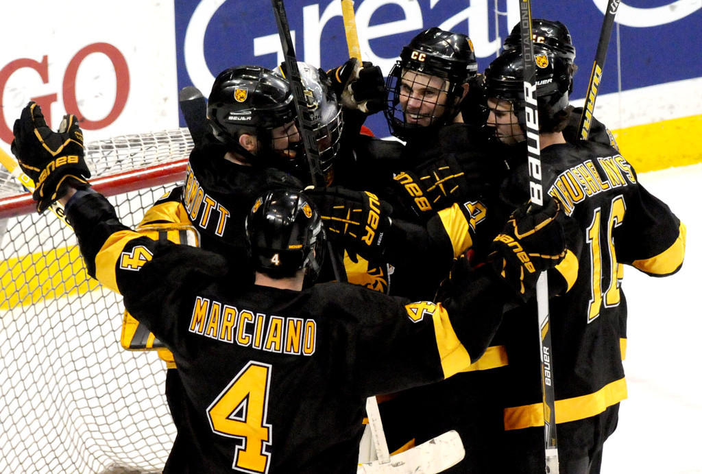 . Members of the Colorado College team surround goaltender Joe Howe after the 2 to 0 win over Minnesota during the WCHA Final Five semifinals at the Xcel Energy Center Arena on March 22, 2013. (Pioneer Press: Sherri LaRose-Chiglo)