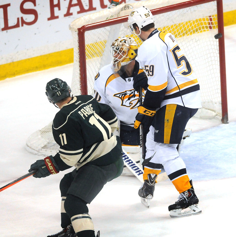 . Zach Parise\'s shot bounces off the far post in the first period of the final game of the season against the Nashville Predators at the Xcel Energy Center in St. Paul on April 13, 2014.  In goal for Nashville is Carter Hutton, as Roman Josi plays defense.   (Pioneer Press: Scott Takushi)