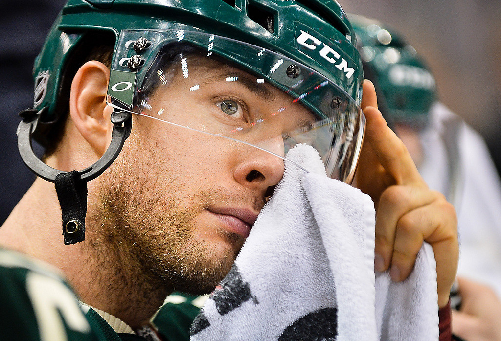 . Wild right wing Jason Pominville wipes sweat from his eyes in the third period against Colorado.  (Pioneer Press: Ben Garvin)