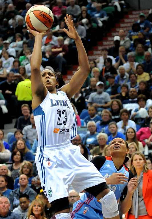 . Minnesota\'s Maya Moore puts up two of her 23 points over Atlanta\'s Armintie Herrington during the second quarter. (Pioneer Press: Sherri LaRose-Chiglo)