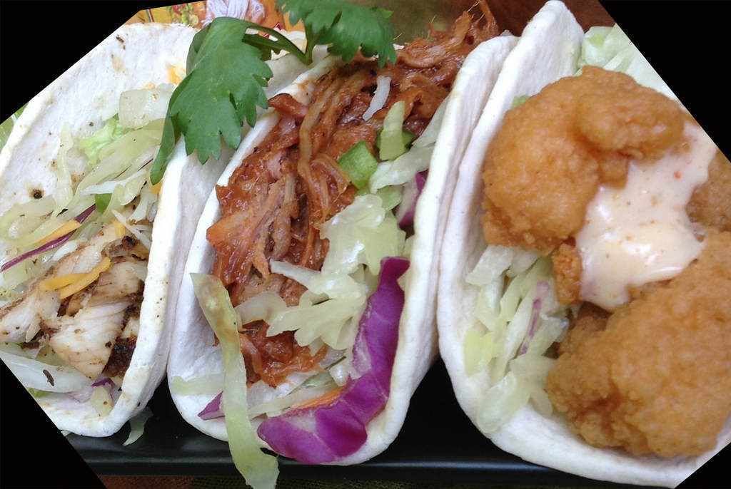 . Café Caribe\'s Taco Slider Trio -- A sampler of 3 bite-size tacos: grilled jerk chicken with cheese; pulled pork smothered in a tangy BBQ sauce; and crunchy shrimp topped with creamy chipotle sauce. All are garnished with citrus slaw. Available at Café Caribe, located on Carnes Ave., near Chambers St. Photo courtesy of the Minnesota State Fair.