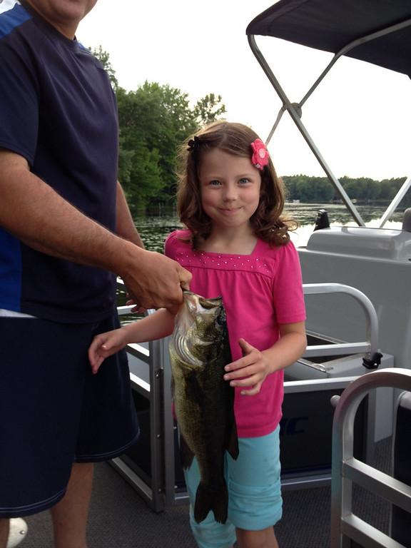 . While fishing for sun fish off the dock, Sara Griffith 9, Farmington, caught this Largemouth Bass on Deer Lake in Spooner, Wisconsin. (Photo courtesy Michel Griffith)